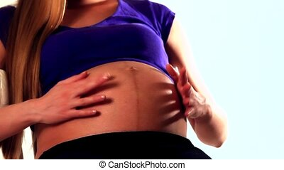isolated video with girl: pregnant woman stroking her belly...