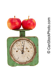 isolated vintage and grunge scale with apples