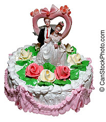 Isolated wedding cake with figurines of groom and bride
