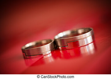 Isolated wedding rings with red background