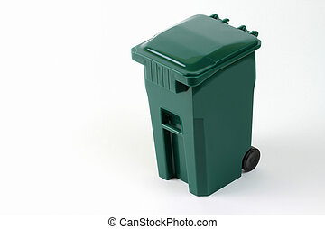 Isolated wheeled green trash can against a white background