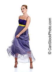 woman in a purple dress dancing