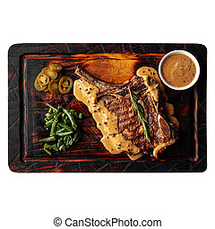 Isolated wooden board with grilled beef steak