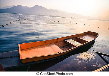 Isolated Wooden Boat on a River