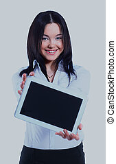 Isolated young business woman showing digital tablet.