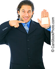 Isolated Young Businessman Pointing At Empty Post It