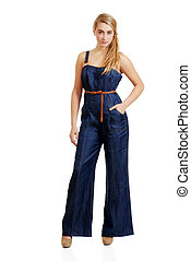 isolated young female teenager in jeans jumpsuit on white background