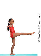 Young girl doing gymnastics balance