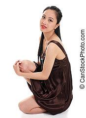 oriental woman in a brown dress