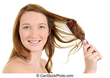 Young teen girl curling her hair