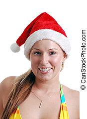 young woman wearing a santa hat