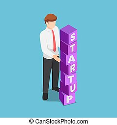 Isometric businessman arranging blocks with the word STARTUP