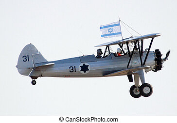 Israel Air Force - Air Show - An Avia BH-21 plane shows off...