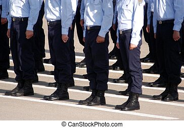 Newly graduated Israeli Air Force pilots stand in formation during their graduation ceremony at the Hatzerim Air Force base near the Southern Israeli city of Beer Sheva on June 28, 2007.