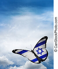 Israel flag butterfly flying on sky background