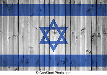 Israel flag depicted in bright paint colors on old wooden wall. Textured banner on rough background