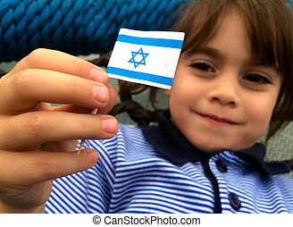 Israeli child holds Israel flag - Israeli child (girl age...