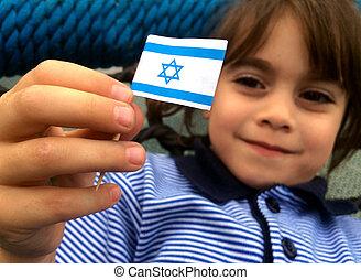 Israeli child holds Israel flag - Israeli child (girl age...