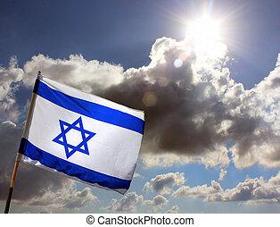 Israeli flag against cloudy sky - Israeli flag on the ...