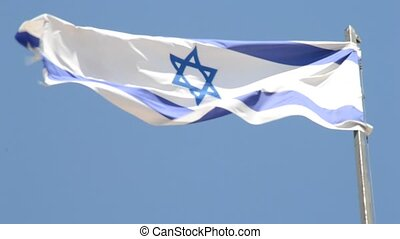 Israeli National flag waving in the wind at Mount of Olive...