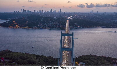 Istanbul Bosphorus Bridge at Sunset with Car traffic lights and City Skyline, Aerial Hyperlapse Motion Time Lapse slide