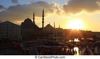 Yeni Mosque and Eminonu region against sunset.