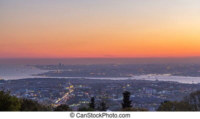 Istanbul classical night skyline scenery day to night transition timelapse, view over Bosporus channel from Camlica hill. Blue water of Bosporus channel with ship. Traffic on roads