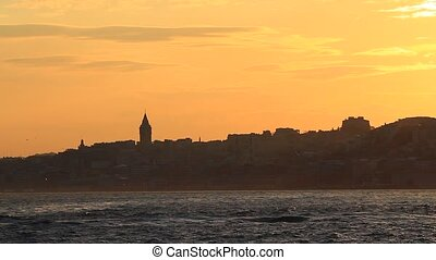 Istanbul, Karakoy at sunset. In the distance are Galata Tower and the city silhouette.