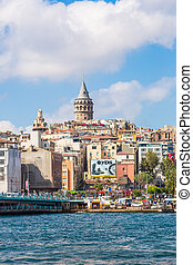 ISTANBUL - MAY 24, 2013: Tourist boat floats past the Galata...