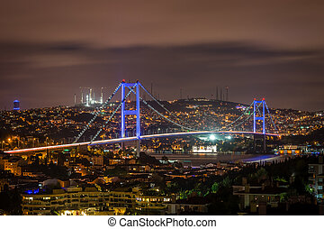 Istanbul night cityscape. Bosphorus bridge