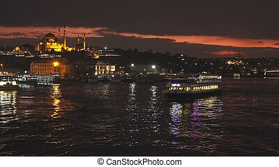 Istanbul night cityscape with looking over Golden Horn to Suleymaniye Mosque on a twilight dramatic sky. 4K UHD video, 3840, 2160p.