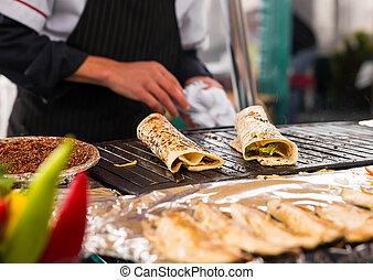 Istanbul the capital of Turkey - Cooking salmon kebab...