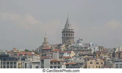 Istanbul, Turkey - June 11, 2019: June 11, 2019: Istanbul view of the Galata Tower from the waterside. Eminonu side is major travel and tourism center in the city