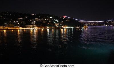 Istanbul's bridge and hills at night