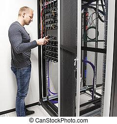 IT consultant install data racks in datacenter