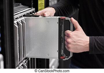 IT consultant installs Blade Server - IT technician,...