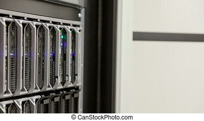 IT consultant removes blade server in datacenter
