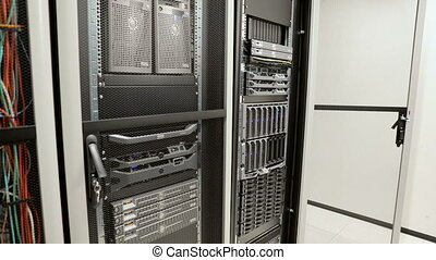 It engineer or consultant working with a blade server in data rack. Shot in enterprise datacenter.