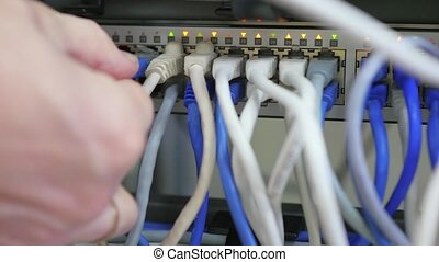 it engineer conducts maintenance work in the server room