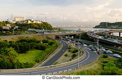It is a beautiful cityscape of interchange and cars.