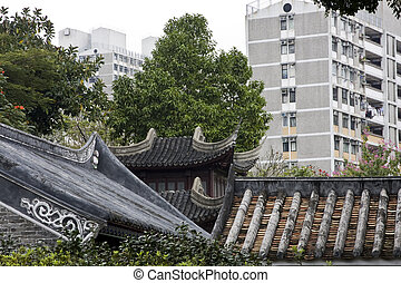 it is a old chinese building and morden building. make a strong comparison to show the living.