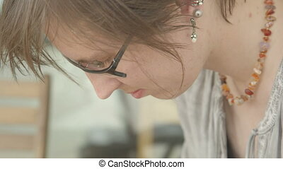 It is close-up image of concentrated female artist working....