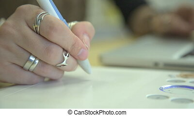 It is close-up image of woman hand drawing using graphic ...