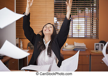 It is finally friday! - Happy businesswoman tossing papers ...