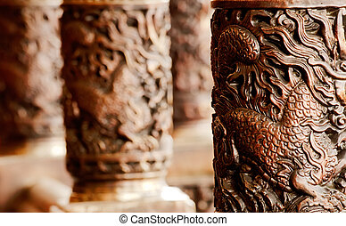 golden chinese style carving decoration in the pillar