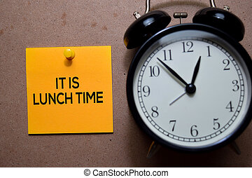 It Is Lunch Time write on Sticky note. Isolated on wooden table