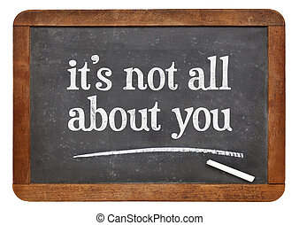 It is not all about you - a reminder in white chalk on a ...