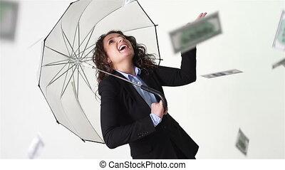 It Is Raining Money - Happy girl in formalwear hiding from a...