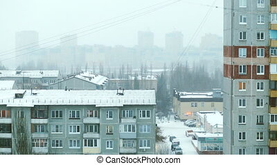 snowing in the district of multistory buildings