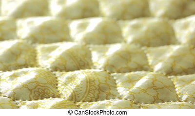 It is the yellow stitch quilt. background or texture. - It...